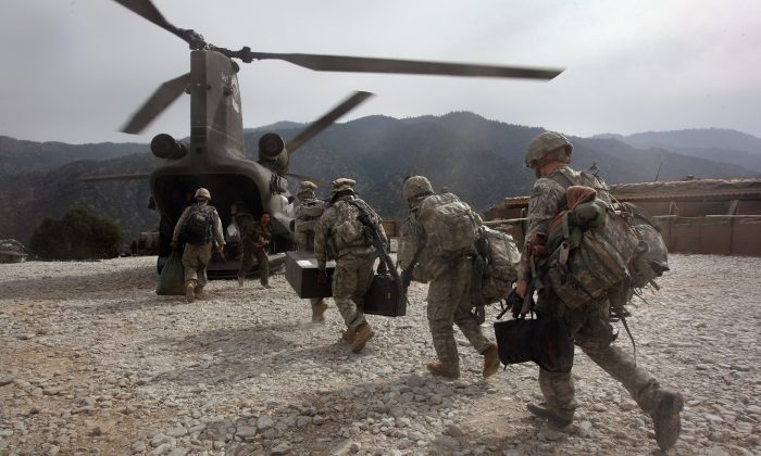 U.S. soldiers board an Army Chinook transport helicopter after it brought fresh soldiers and supplies to the Korengal Outpost in the Korengal Valley, Afghanistan, on Oct. 27, 2008.   John Moore/Getty Images