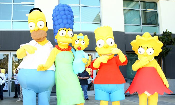 """""""The Simpsons"""" characters pose for a postage stamp dedication ceremony in Los Angeles, Calif., on May 7, 2009. (Alberto E. Rodriguez/Getty Images)"""