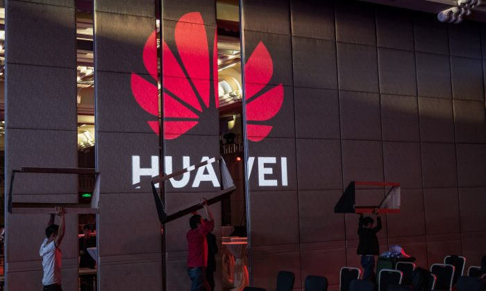 Workers prepare the venue for a Huawei summit on April 16, 2019, in Shenzhen, China. (Billy H.C. Kwok/Getty Images)