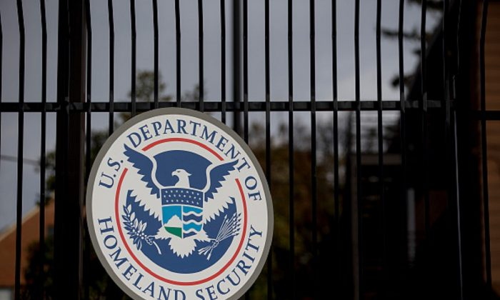 The U.S. Department of Homeland Security (DHS) seal hangs on a fence at the agency's headquarters in Washington, on Dec. 11, 2014. (Andrew Harrer/Bloomberg via Getty Images)