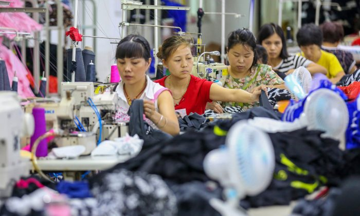 Workers at a swimwear factory in Jinjiang, Fujian Province, China, on Aug. 2, 2018. (STR/AFP/Getty Images)