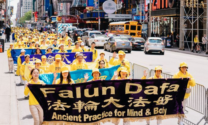 Thousands of Falun Gong practitioners walk through streets of Manhattan, New York on May 16, 2019, to celebrate World Falun Dafa Day and call for the end of the persecution of the practice in China. (Edward Dye/The Epoch Times)
