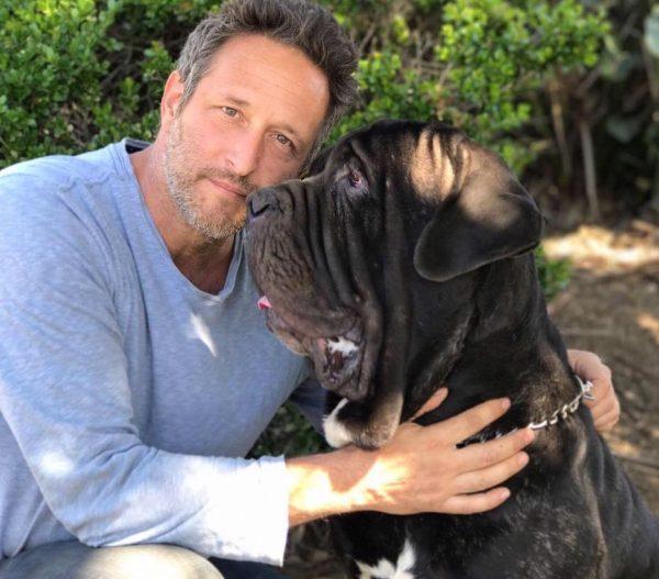 Schwab with a big dog