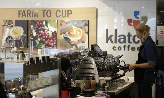A barista prepares an order at Klatch Coffee in San Francisco, on May 15, 2019. (AP Photo/Jeff Chiu)