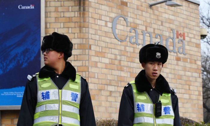 Police officers stand guard outside the Canadian embassy in Beijing on Jan. 27, 2019. (Greg Baker/AFP/Getty Images)