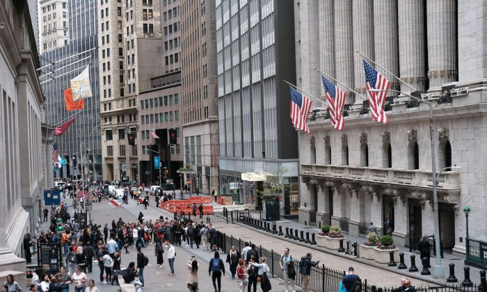 People walk outside of the New York stock Exchange (NYSE) in New York City on May 6, 2019. (Spencer Platt/Getty Images)