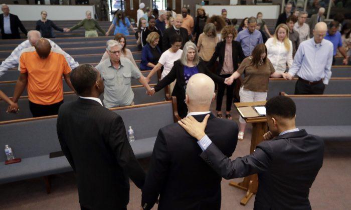 People pray for Don Johnson at Riverside Seventh-Day Adventist Church, in Nashville, Tenn., on May 16, 2019. (Mark Humphrey/AP Photo)
