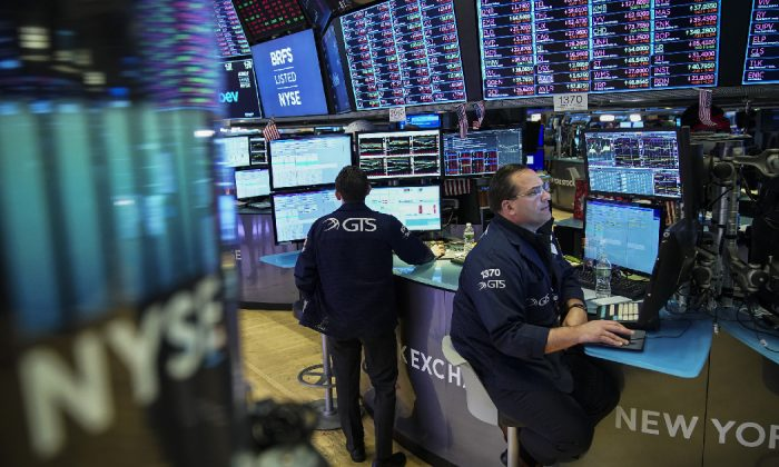 Traders and financial professionals work ahead of the closing bell on the floor of the New York Stock Exchange (NYSE) in New York City on May 13, 2019.