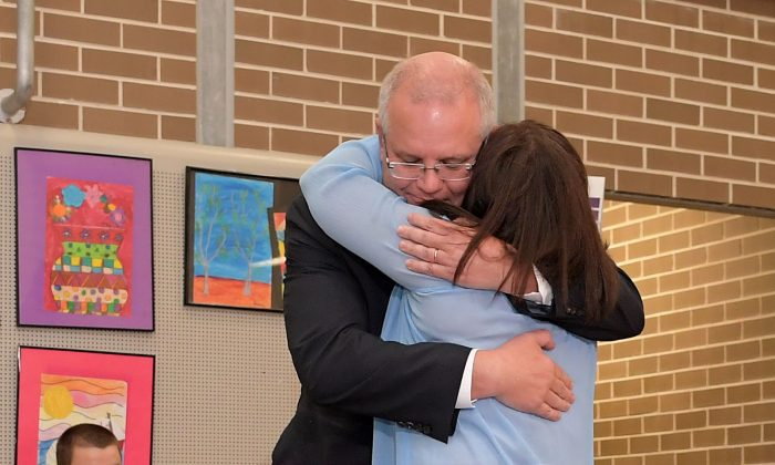 Prime Minister Scott Morrison and wife Jenny Morrison hug at Lilli Pilli Public School in Sydney, Australia, on May 18, 2019. (Tracey Nearmy/Getty Images)