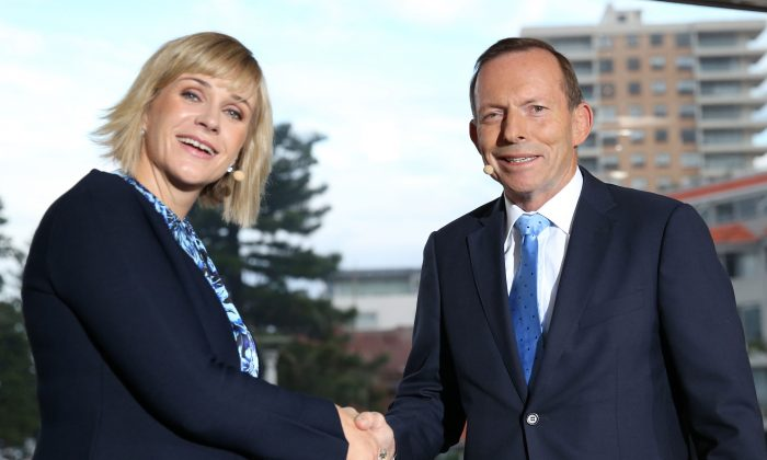 Federal Member for Warringah Elect Zali Steggall (L) and former Prime Minister and outgoing Member Tony Abbott participate in the Sky News/Manly Daily Debate at Queenscliff Surf Club in Sydney, Australia, on May 2, 2019. (Damian Shaw/News Corp Australia via Getty Images)