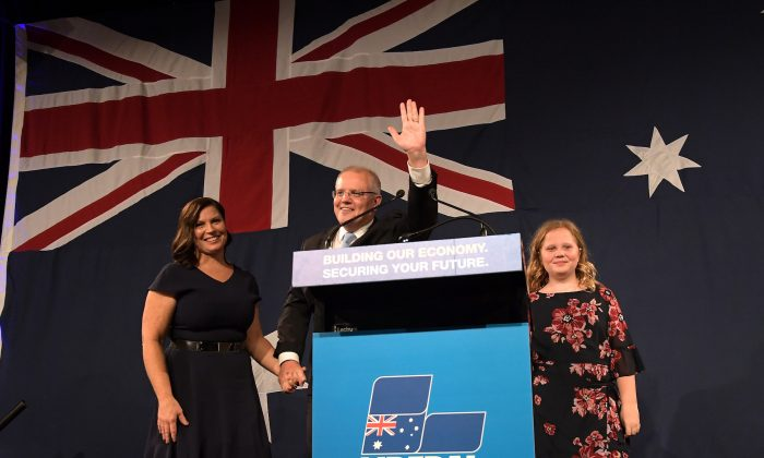 Prime Minister of Australia and leader of the Liberal Party Scott Morrison, flanked by his wife Jenny Morrison and daughters Lily Morrison and Abbey Morrison, delivers his victory speech at the Sofitel Sydney Wentworth in Sydney, Australia on May 18, 2019. Prime Minister Scott Morrison was re-elected today, securing another three-year team for the Liberal-National coalition following an intense five-week campaign against Bill Shorten and the Labor party. (Tracey Nearmy/Getty Images)