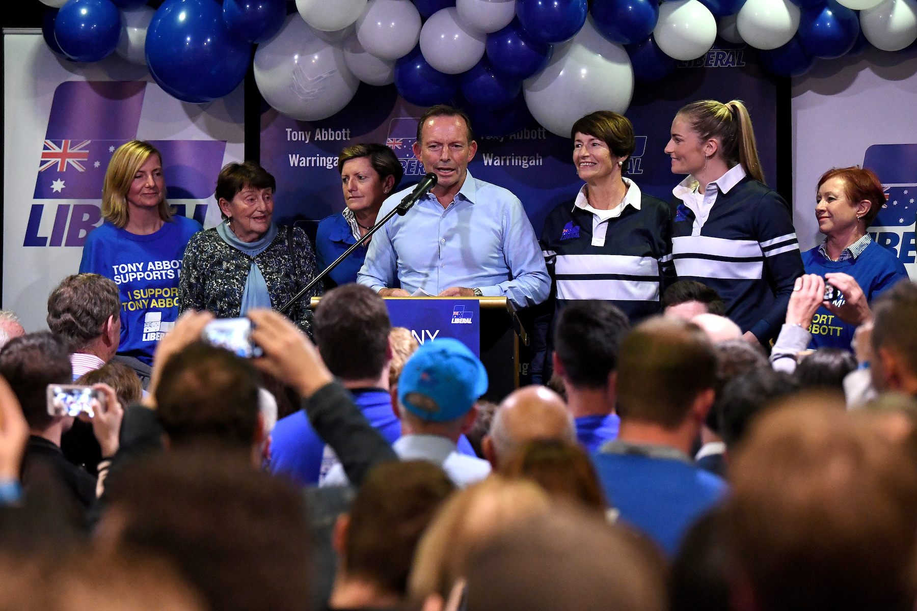 Australia's former Prime Minister and Warringah Liberal candidate Tony Abbott is joined on stage by family members after conceding defeat at Manly Leagues Club in Brookvale, Sydney