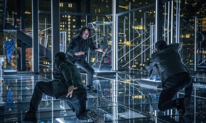 """Keanu Reeves as John Wick, fighting off assassins in """"John Wick: Chapter 3 — Parabellum."""" (Lionsgate)"""