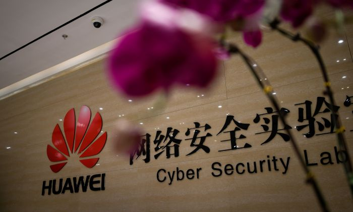 A Huawei logo is seen at the entrance of the Huawei Cyber Security Lab at a Huawei production base during a media tour in Dongguan City, Guangdong Province, China, on March 6, 2019. (WANG ZHAO/AFP/Getty Images)