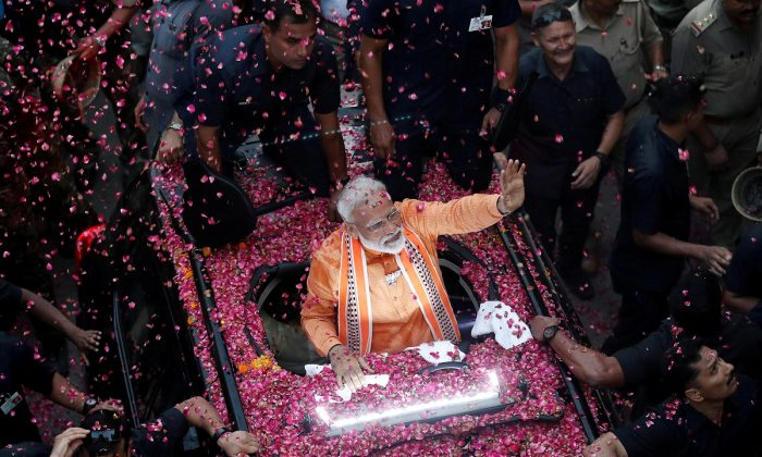 India's Prime Minister Narendra Modi waves towards his supporters during a roadshow in Varanasi, India, on April 25, 2019. (Adnan Abidi/Reuters)