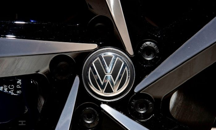 A Volkswagen logo appears on the wheel of a VW Passat GTE Variant on display in Berlin on May 14, 2019. (John Macdougall/AFP/Getty Images)