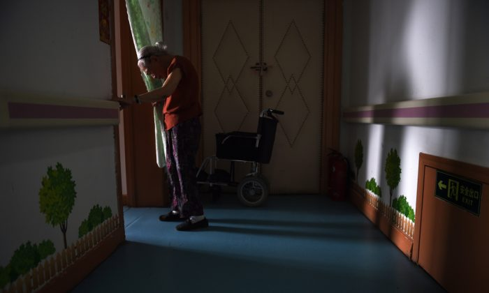An elderly woman in a Chinese retirement home. (Greg Baker/AFP/Getty Images)