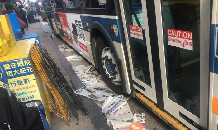 Newspaper copies of the Chinese-language edition of The Epoch Times, scattered on the ground after an apparent attempt to sabotage the publication's newspaper boxes, on May 11, 2019. (Courtesy of Sun Tong)