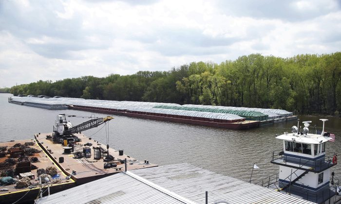 Barges already loaded with soy beans, potash or scrap steel await movement on the Mississippi River in St. Paul, Minn., (Jim Mone/AP)