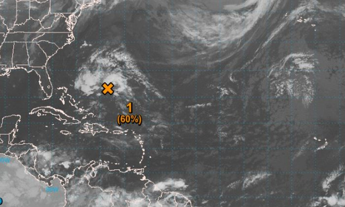A tropical cyclone might develop in the Atlantic Ocean this week, located about 1,000 miles east of Florida. (NHC)