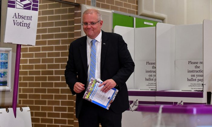 Australian Prime Minister Scott Morrison casts his vote on Election day, at Lilli Pilli Public School, in Sydney on 18 May, 2019. (Mick Tsikas/AAP/via Reuters)