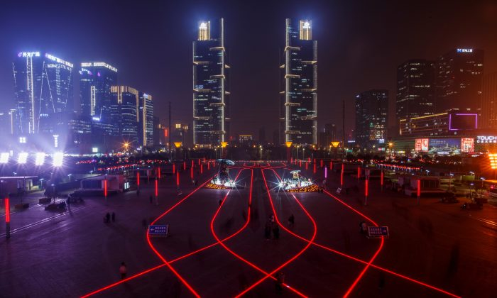 LED lights in the pavement illuminate the square in front of the highspeed railway station in the new business district of Zhengzhou, Henan Province, China on Feb. 22, 2019. (Thomas Peter/Reuters)