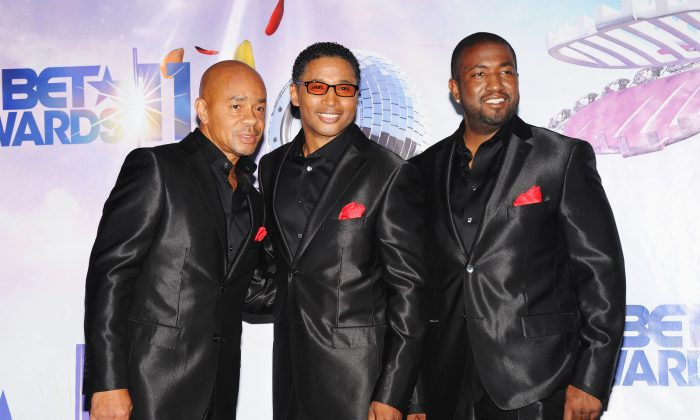 Keith Mitchell, Melvin Edmonds (M) and Kevon Edmonds of the musical group After 7 at the BET Awards '11 held at the Shrine Auditorium in Los Angeles, Calif., on June 26, 2011. (Jason Merritt/Getty Images)