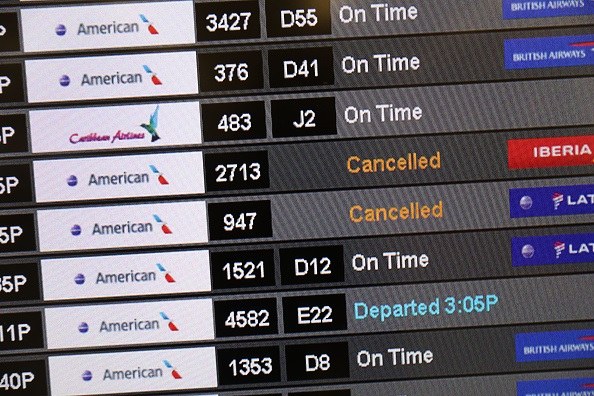 A sign at the Miami International Airport shows cancelled flights