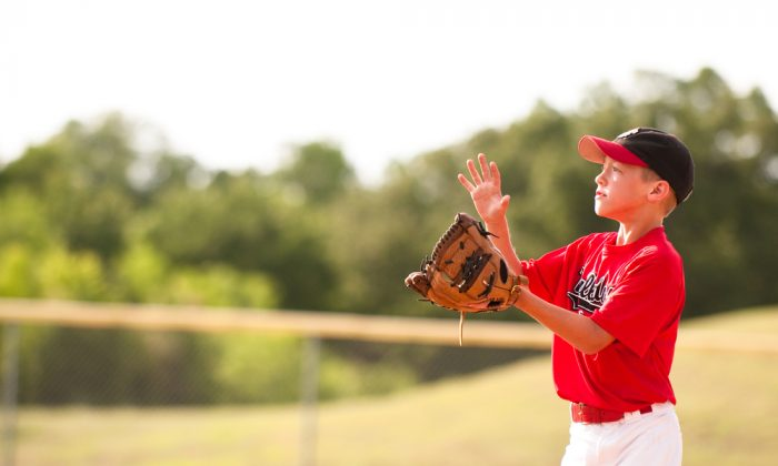 Like many a young boy, once I became old enough I signed up for Little League baseball. (tammykayphoto/shutterstock)