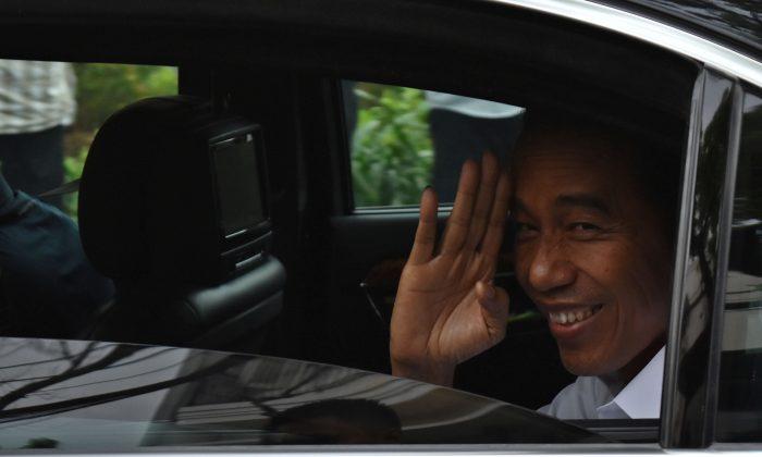Incumbent Indonesian president Joko Widodo leaves after a press briefing in Jakarta, Indonesia, April 18, 2019. (Antara Foto/Aditya Pradana Putra/ via Reuters)