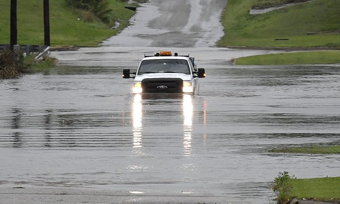 The underpass on north Grand is closed due to high water in Enid, Okla., on May 20, 2019. (Billy Hefton/The Enid News & Eagle via AP)