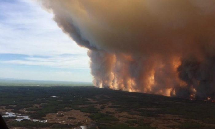 The Chuckegg Creek fire is seen from the air in a Government of Alberta handout photo taken near the town of High Level, AB. on May 19, 2019. (Ho/The Canadian Press)