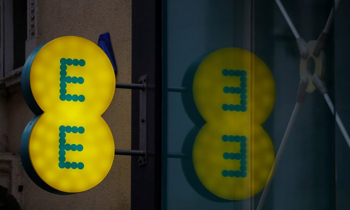 Signage is seen outside an EE mobile phone shop in Manchester, Britain on Sept. 21, 2017. (Phil Noble/Reuters)
