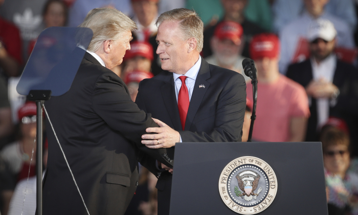 President Donald Trump shakes hands with Fred Keller, Republican candidate for Congress in Pennsylvania's 12th Congressional district, during a 'Make America Great Again' campaign rally at Williamsport Regional Airport in Montoursville, Pa., on May 20, 2019. (Drew Angerer/Getty Images)