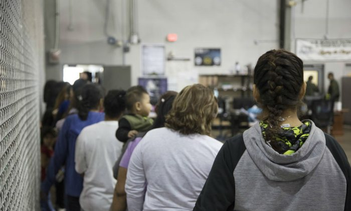 In this handout photo provided by U.S. Customs and Border Protection, U.S. Border Patrol agents conduct intake of illegal border crossers at the Central Processing Center on June 17, 2018 in McAllen, Texas. (Photo by U.S. Customs and Border Protection via Getty Images)