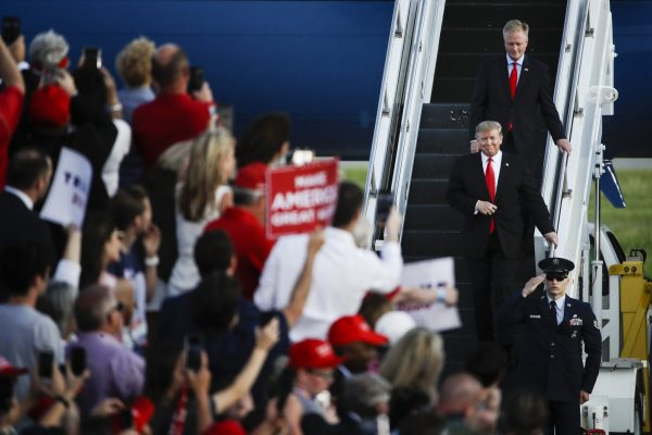 President Donald Trump accompanied by Rep. Fred Keller,