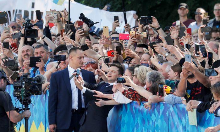 Ukraine's President-elect Volodymyr Zelenskiytakes a selfie with his supporters as he walksto takethe oath of office in Kiev, Ukraine on May 20, 2019. (Gleb Garanich/Reuters)