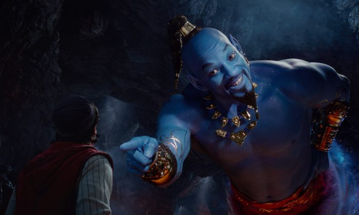 "Mena Massoud as Aladdin (L) and Will Smith as Genie in Disney's live-action adaptation of the 1992 animated classic ""Aladdin."" (Disney via AP)"