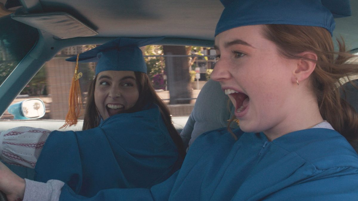 2 girls driving to graduation
