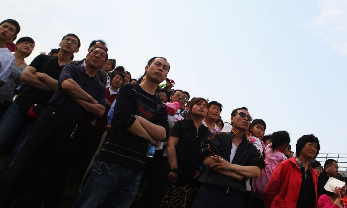 Chinese onlookers. (Feng Li/Getty Images)