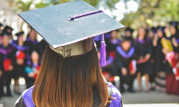 Stock image of a female graduate. (MD Duran/Unsplash)