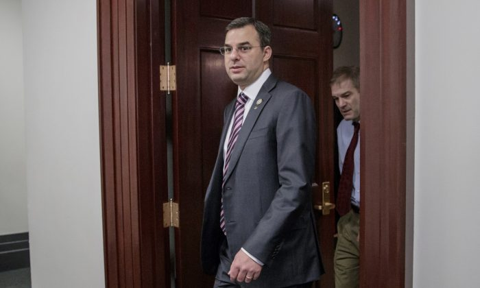 Rep. Justin Amash, R-Mich., followed by Rep. Jim Jordan, R-Ohio, leaving a closed-door strategy session on March 28, 2017. (J. Scott Applewhite/AP Photo)