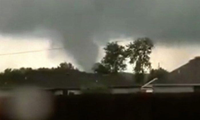 This still image taken from video provided by Shayla Brooks shows a tornado in Carl Junction, Mo., on May 22, 2019. (Shayla Brooks via AP)
