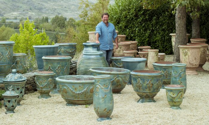 """The French Potter,"" Yannick Fourbet, with a selection of his horticultural pots at his home on the ""Domaine Rewa"" vineyard on New Zealand's South Island. (Rachael McKenna)"
