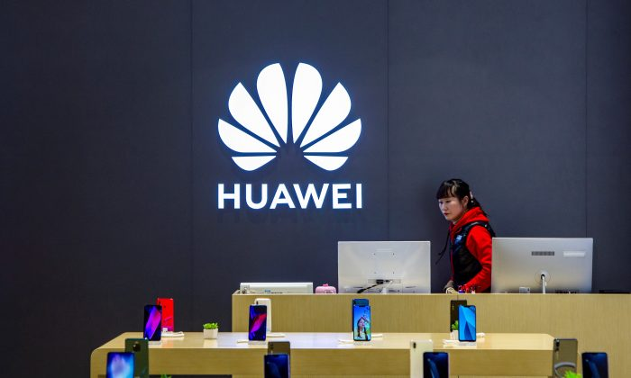 A staff member is seen inside a Huawei retail store in Shanghai, China on May 8, 2019. (Reuters)
