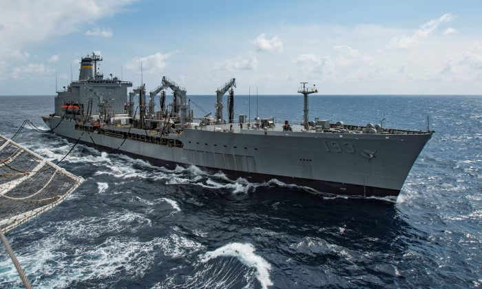 Military Sealift Command fleet replenishment oiler USNS Walter S. Diehl (T-AO 193) pulls alongside hospital ship USNS Mercy (T-AH 19) to deliver supplies and mail by a connected replenishment in the South China Sea on Aug. 15, 2016. ( U.S. Marine Corps photo by Sgt. Brittney Vella/Handout via Reuters)