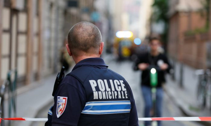 A policeman looks on near the site of a suspected bomb attack in central Lyon, France, on May 24, 2019. (Emmanuel Foudrot/Reuters)