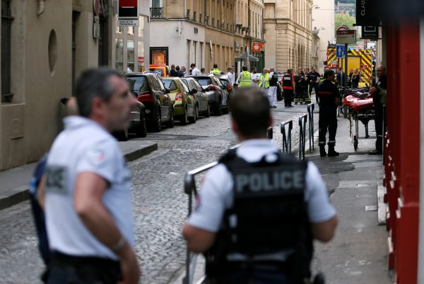 Police officers, fire fighters and medics are seen near the site of a suspected bomb attack in central Lyon