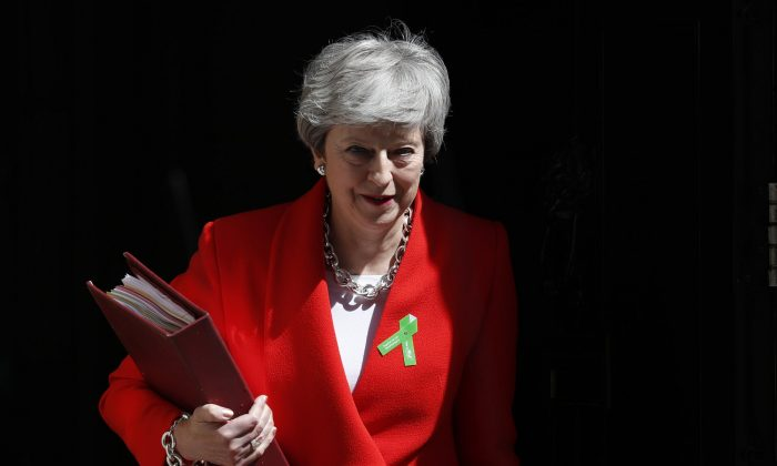 Britain's Prime Minister Theresa May leaves 10 Downing Street for her weekly Prime Minister's Questions in the House of Commons in London on May 15, 2019. (Alastair Grant/Photo via AP)