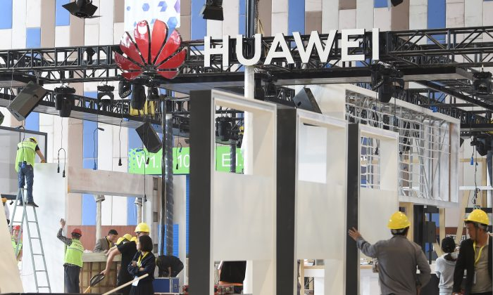 Workers are seen near the booth of Huawei under construction at the venue of China International Big Data Industry Expo in Guiyang, Guizhou Province, China, on May 22, 2019. (Reuters)